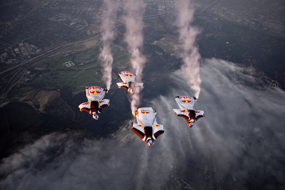 Jon Devore, Miles Daisher, Luke Aikins and Mike Swanson, of the Red Bull Air Force Team, soar over the Hollywood sign, during LA Swoopers, in Los Angeles, CA, USA, on 20 October 2011.